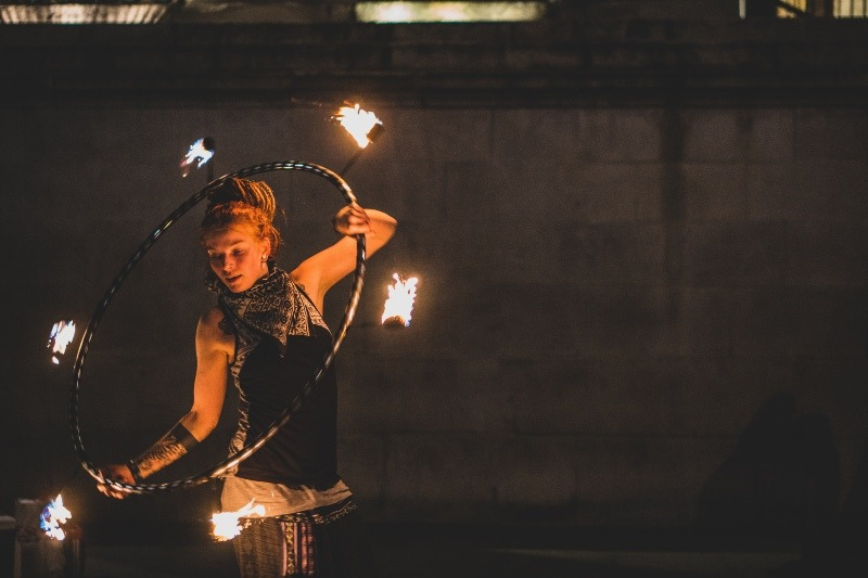 woman spinning fire hoop